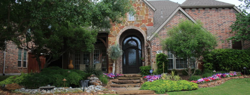 front landscape with water feature